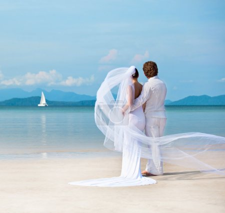 Photo for Beautiful couple on the beach in wedding dress - Royalty Free Image
