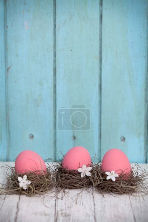 Photo for Pink easter eggs on the table nest - Royalty Free Image