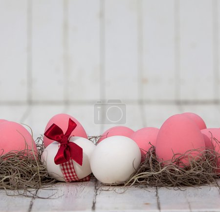 Photo for Pink easter eggs on the table - Royalty Free Image