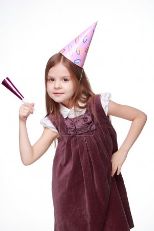 Cheerful kid girl on Holiday party Studio portrait of pretty joyful kid girl on birthday party