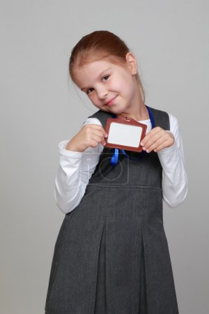 Little girl with a blank name tag