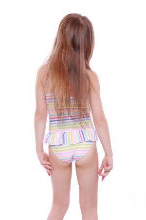 Photo for Fashion little girl in swimsuit stands back on white - Royalty Free Image
