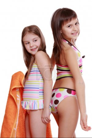 Photo for Young girls holding orange towel - Royalty Free Image