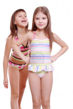 Photo for Cheerful and funny little girls wearing summer swimsuits - Royalty Free Image