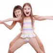 Cheerful and funny little girls in a swimsuit...