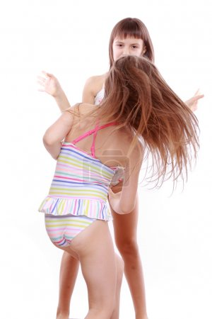 Photo for Cheerful and funny little girls in a swimsuit - Royalty Free Image