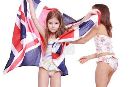 Girls in swimsuit holding British flag