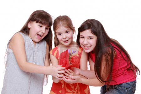 Girls holding spring flower in pot