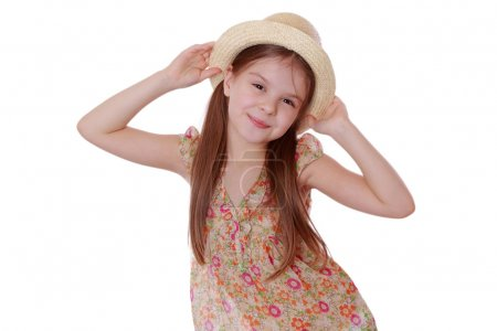 Little girl in summer dress and straw hat