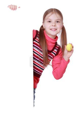 Girl holding Easter egg and white blank
