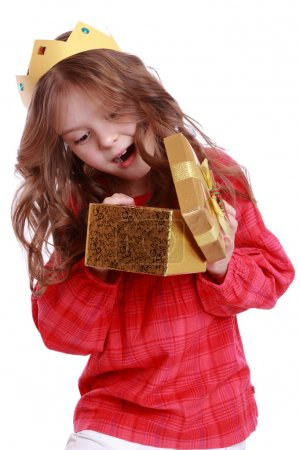 Girl wearing paper crown and holding present box