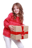 Little girl holding present box