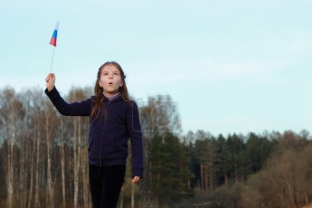 Patriotic little girl holding Russian flag