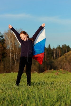 Girl holding a large Russian flag