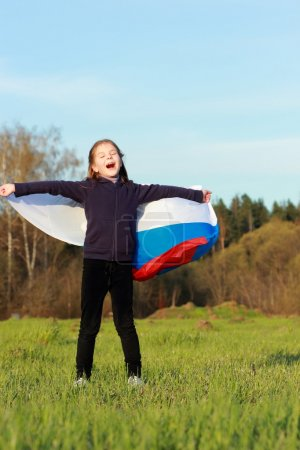 Beautiful little girl with Russian flag