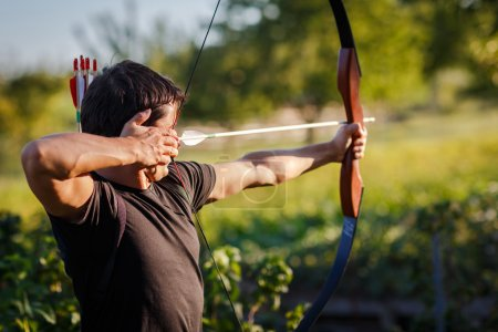 Young archer training with the bow...
