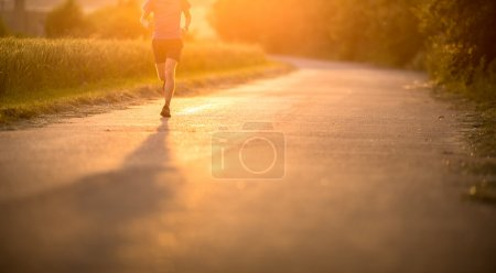 Male athlete,runner running on road