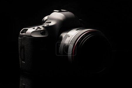 Professional modern DSLR camera low key image - Mo...