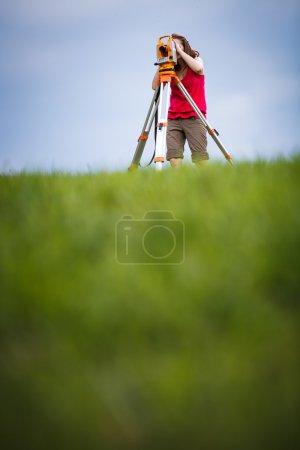 Female land surveyor at work