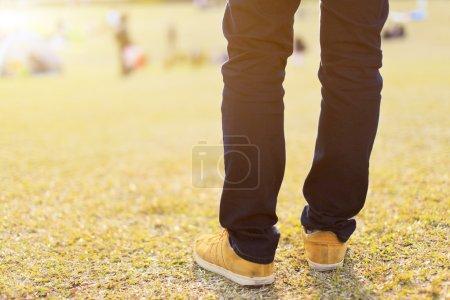 Man's leg under sunset