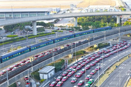 Highway in modern city with moving train