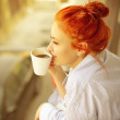 Good morning womans with cup of fragrant coffee on...