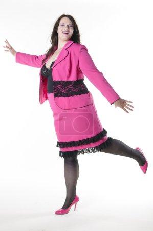 XXL Model wears a pink costume