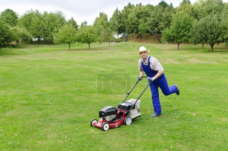 Gardening, man mowing the lawn