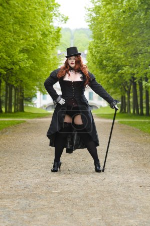 Plus size model wearing fancy dress in Park