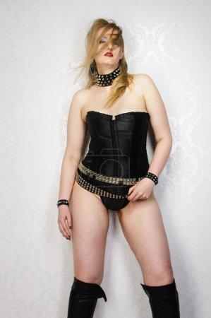Punk woman wearing black corset
