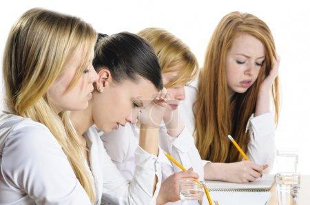 Four Girls writing
