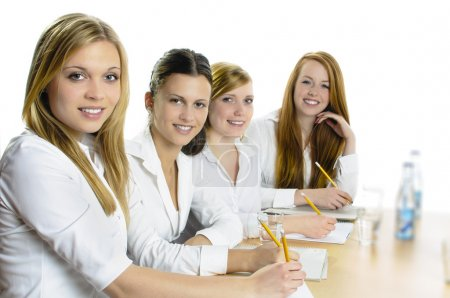 Female Pupils Studying At Desk