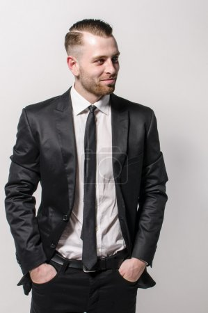 Man with tie smiling