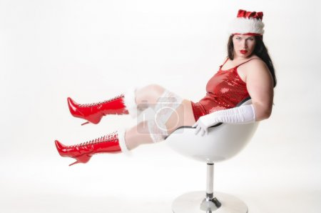 Sexy christmas woman in armchair