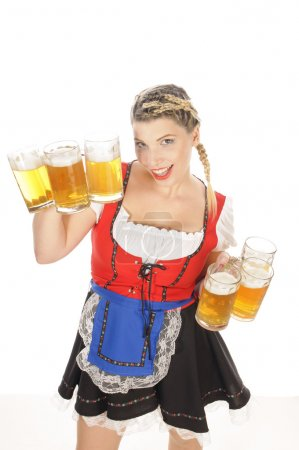 Oktoberfest, young waitress in dirndl with many beer mugs