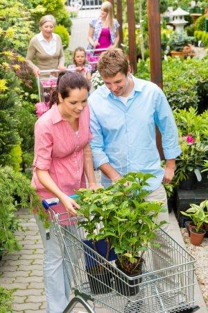 Garden centre young couple shopping plant flower