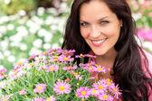 Portrait of beautiful woman with purple flowers