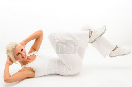 Fitness instructor exercise abdominals white floor