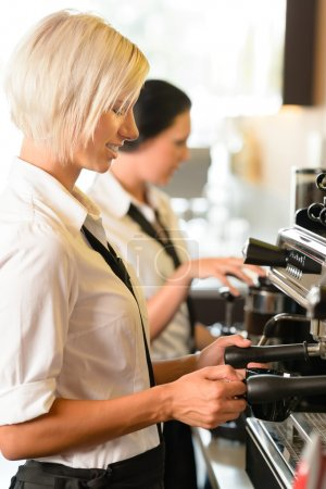Photo for Waitresses at work make coffee machine cafe smiling woman espresso - Royalty Free Image