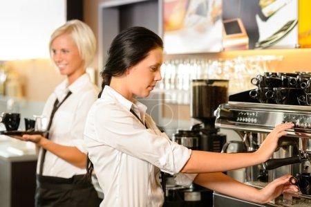 Staff at cafe making coffee espresso machine