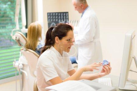 Dental surgery nurse hold print of teeth