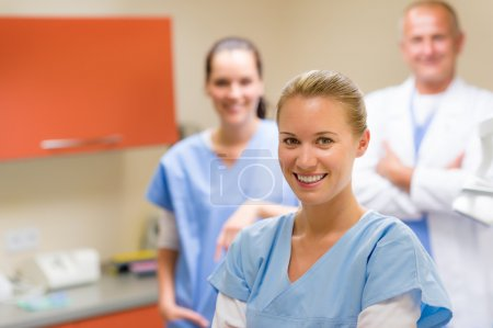 Smiling medical professional team at the surgery