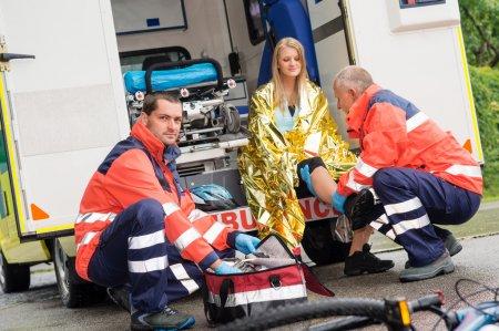 Bike accident woman emergency doctor checking leg