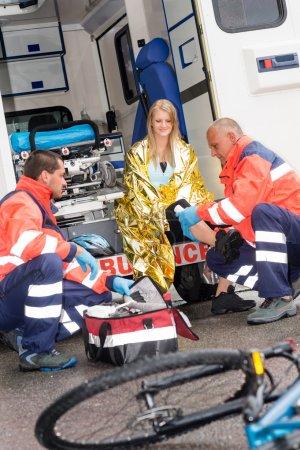 Bike accident woman emergency doctor bandage leg