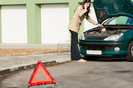 Photo for Car breakdown couple calling for road assistance look engine - Royalty Free Image