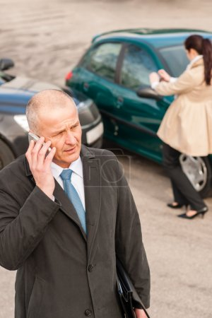 Man on the phone after colliding car