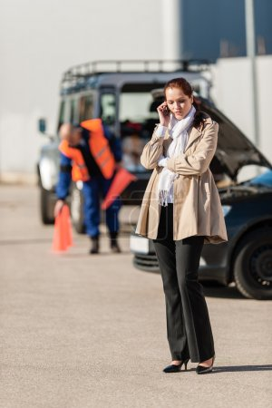 Woman on the phone after car breakdown