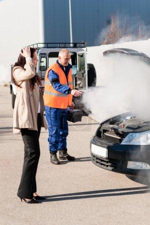 Car breakdown woman get help road-assistance man