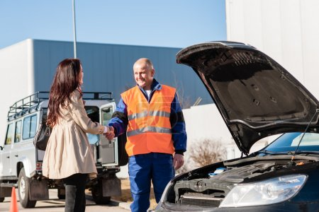 Photo for Woman shaking hands with mechanic car breakdown crash accident man - Royalty Free Image