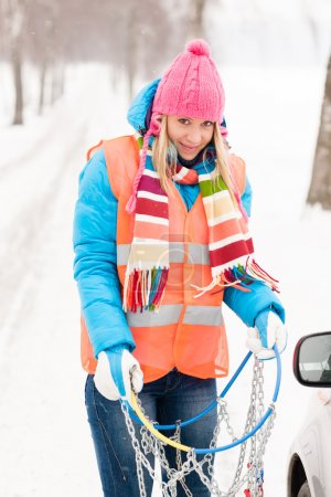 Woman winter car problems tire chains